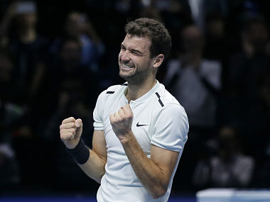 Grigor Dimitrov of Bulgaria celebrates after defeating David Goffin of Belgium in their ATP World Tour Finals singles final tennis match at the O2 Arena in London, Sunday Nov. 19, 2017. (AP Photo/Tim Ireland)