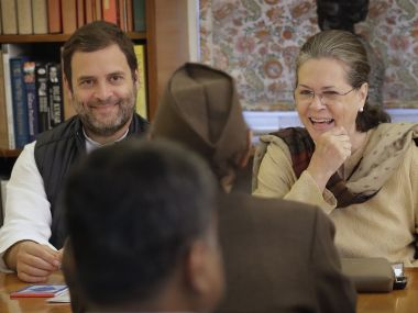 Congress chief Sonia Gandhi with party vice-president Rahul Gandhi at the party working committee meeting in New Delhi on Monday. AP