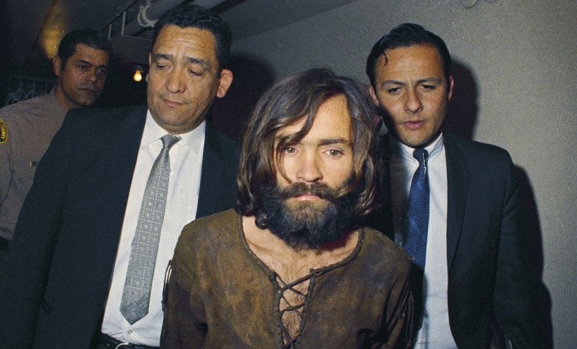 A file photo of Charles Manson being escorted to his arraignment on conspiracy-murder charges in connection with the Sharon Tate murder case. AP