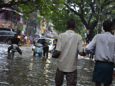 A file photo of a flooded street in Chennai suburb. PTI