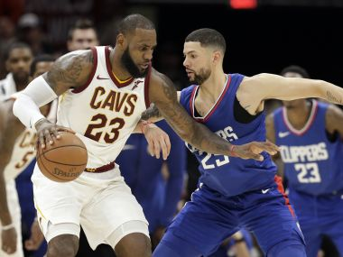 Cleveland Cavaliers' LeBron James works against LA Clippers' Austin Rivers in their game. AP