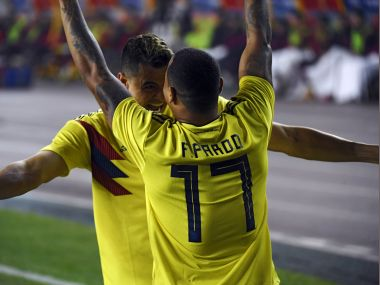 Colombia's Edgar Parado (R) celebrates with teammate Giovanni Moreno after scoring a goal during their international friendly football match against China. AFP