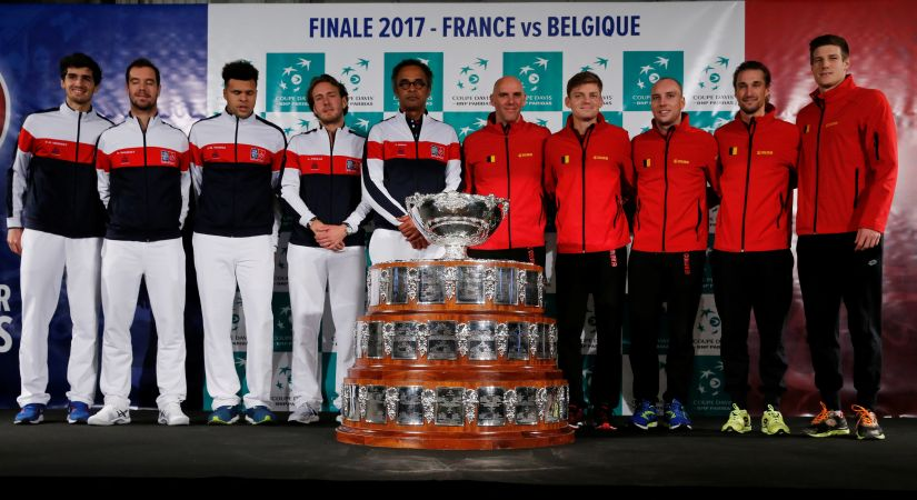 Belgium captain Johan Van Herck, Steve Darcis, David Goffin, Arthur De Greef, Ruben Bemelmans and Joris De Loore along with France captain Yannick Noah, Lucas Pouille, Jo-Wilfried Tsonga, Richard Gasquet and Pierre-Hugues Herbert pose with the Davis Cup trophy ahead of the final. Reuters