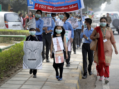 File image of school children marching to express their distress on the alarming levels of pollution in Delhi. AP