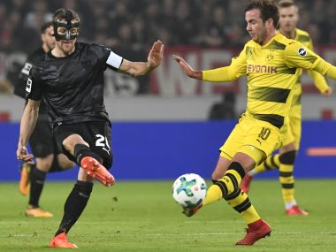 Stuttgart's midfielder Christian Gentner (L) and Dortmund's  midfielder Mario Goetze vie for the ball. AFP