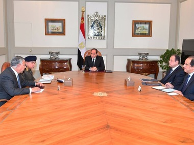 This photo released by Egypt's Presidency shows Abdel-Fattah El-Sissi, center, meeting with officials in Cairo after militants attacked a crowded mosque during Friday prayers in the Sinai Peninsula. The attackers set off explosives, spraying worshippers with gunfire and killing at least 184 people in the deadliest ever attack on Egyptian civilians by Islamic extremists. AP
