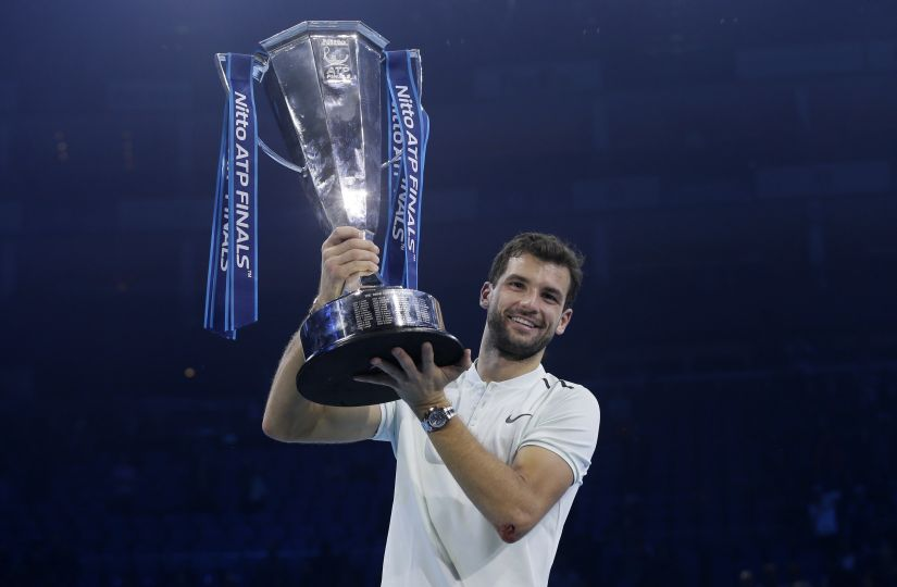 Grigor Dimitrov lifts the trophy after beating David Goffin in their ATP World Tour Finals. AP