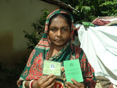 A migrant at a camp in Bangladesh's Kutupalong displays the green card issued by the Myanmarese government. Image courtesy: Rajeev Bhattacharyya