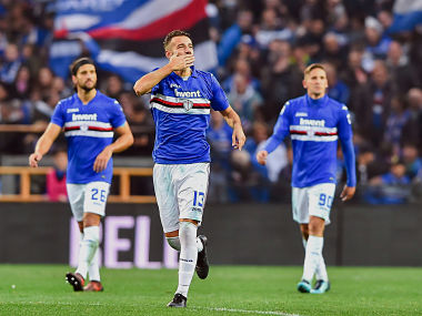 Sampdoria's Gian Marco Ferrari, center, celebrates after scoring his side's 3rd goal during the Serie A soccer match between Sampdoria and Juventus at the Luigi Ferraris Stadium in Genoa, Italy, Sunday, Nov. 19, 2017. Sampdoria won 3-2. (Simone Arveda/ANSA via AP)