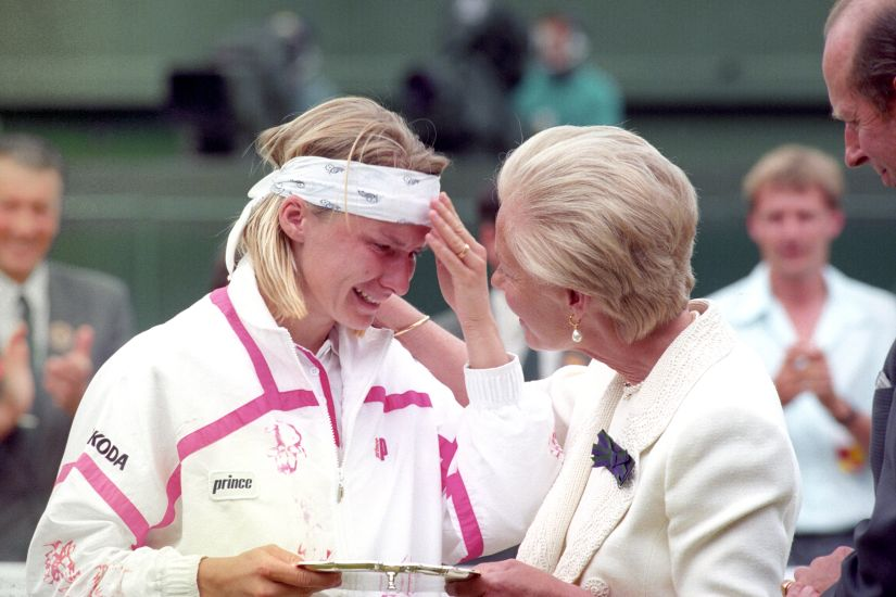 File photo of the Duchess of Kent comforting Jana Novotna as she presents her with the runner up trophy on Centre Court at Wimbledon. Novotna had lost 6-7, 6-1, 4-6 to defending champion Steffi Graf. AP