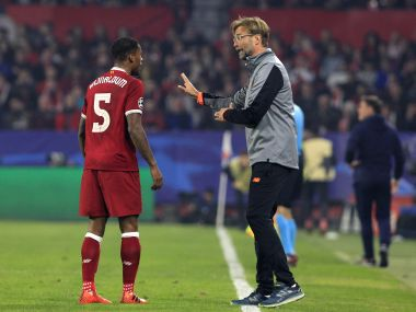 Liverpool coach Jurgen Klopp talks with Georginio Wijnaldum during their Champions League match against Sevilla on Tuesday. AP