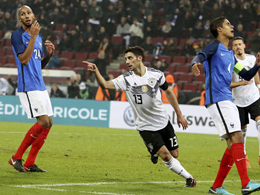Germany's Lars Stindl celebrates besides France's Steven N'Zoni and Raphael Varane after scoring his side's second goal. AP