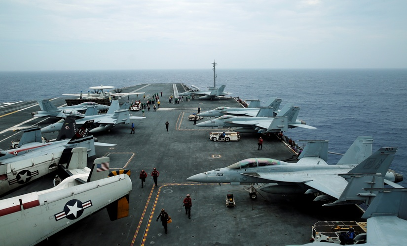 F/A-18 Hornet fighter jets and E-2D Hawkeye plane are seen on the US aircraft carrier John C Stennis during joint military exercise called Malabar, with the United States, Japan and India participating, off Japan's southernmost island of Okinawa, Japan in June 2016. Reuters