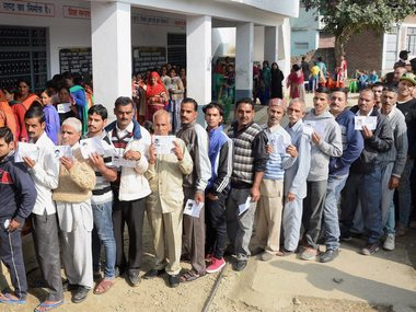 File image of people standing in long queue to cast their votes for Assembly elections in Mandi, Himachal Pradesh on Thursday. PTI