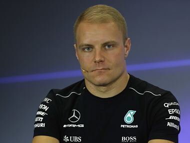 Mercedes driver Valtteri Bottas, of Finland, listen questions during a press conference at the Hermanos Rodriguez racetrack in Mexico City, Thursday, Oct. 26, 2017. (AP Photo/Moises Castillo)