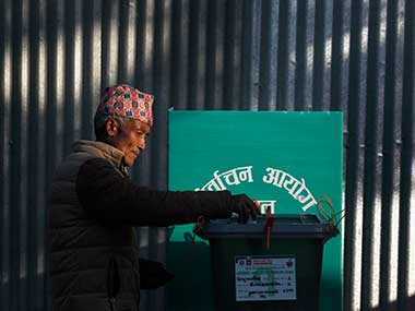 A Nepalese man casts his vote during the legislative elections in Chautara, Nepal. AP
