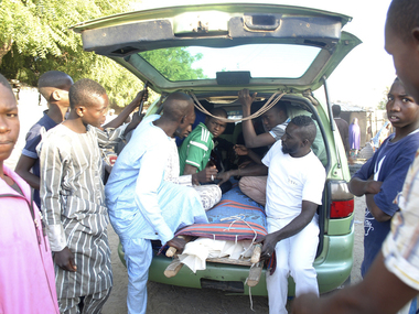 File image of people transporting body of a suicide attack victim for funeral in Maiduguri, Nigeria. AP