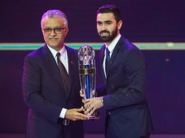 Syria and Al-Hilal player Omar Khrbin (R) receives the Asian Football Confederation Men's Player of the Year award at the AFC Annual Awards in Bangkok. AFP
