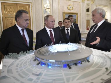 File image of Russia's President Vladimir Putin, Deputy Prime Minister Vitaly Mutko and St. Petersburg's Mayor Georgy Poltavchenko (R) visit an exhibition, dedicated to the infrastructure of host cities for the 2018 FIFA World Cup. Reuters