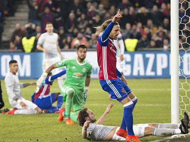 Basel's Michael Lang, foreground, celebrates after scoring a goal, during the Champions League Group A soccer match between Switzerland's FC Basel 1893 and England's Manchester United at the St. Jakob-Park stadium in Basel, Switzerland, Wednesday, Nov. 22, 2017. (Patrick Straub/Keystone via AP)