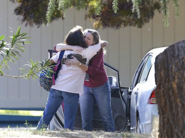 Two women embrace outside Rancho Tehama Elementary School, where a gunman opened fire Tuesday. AP