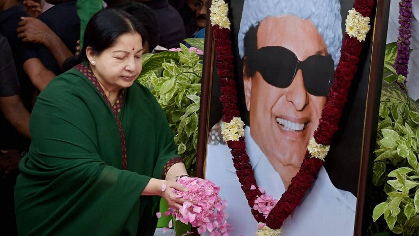 File image of Jayalalithaa paying floral tribute to her mentor MGR. PTI