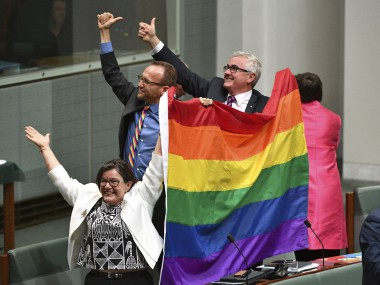 Members of parliament celebrate the passing of the Marriage Amendment Bill in the House of Representatives at Parliament House in Canberra. AP