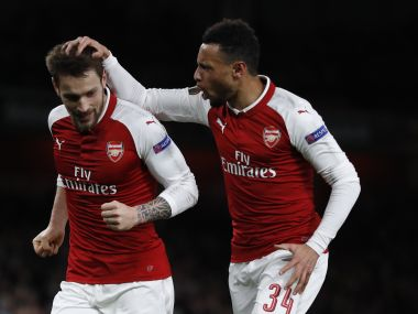 Mathieu Debuchy (left) celebrates scoring Arsenal's first goal with Francis Coquelin. AP