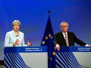 British Prime Minister Theresa May, left, an European Commission President Jean-Claude Juncker address a media conference at EU headquarters in Brussels. AP