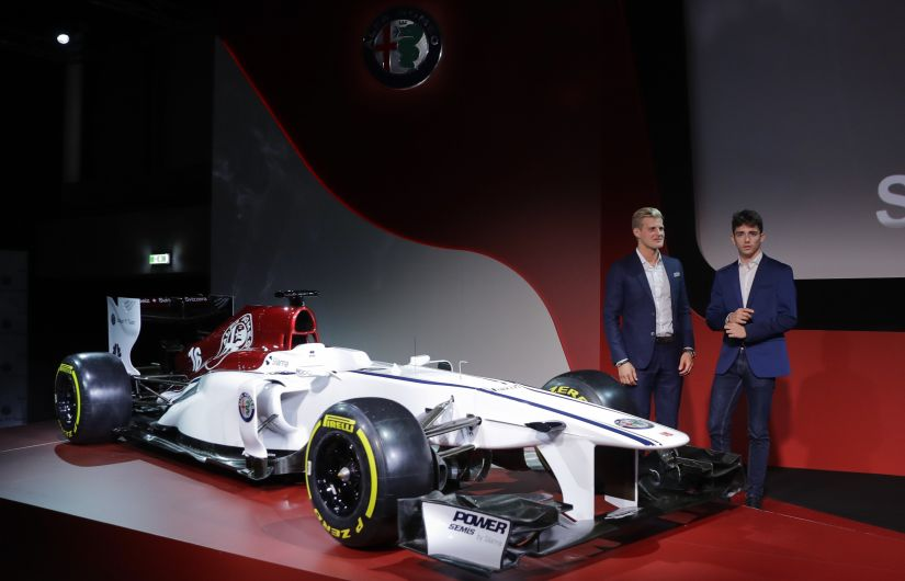 Drivers Marcus Ericsson, left, and Charles Leclerc, unveil the Alfa Romeo Sauber F1 Team on the occasion of the official presentation. AP