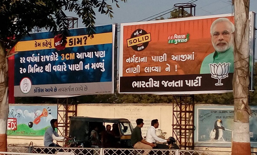Congress and BJP put up posters taunting each other in Rajkot. Firstpost/Parth MN