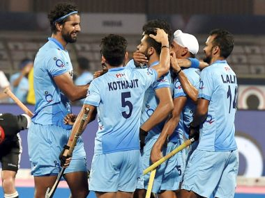 Indian player Harmanpreet Singh (C) celebrate with his teammates after scoring against Germany. PTI