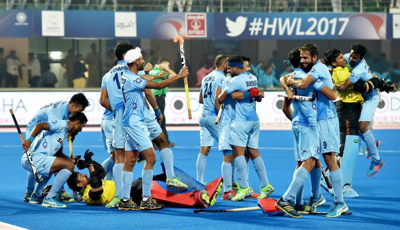 Indian players celebrate after winning their quarter-final match against Belgium in a penalty shootout during Hockey World League Final at Kalinga Stadium in Bhubaneswar. PTI