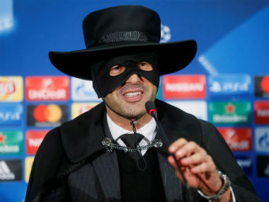 Shakhtar Donetsk's coach Paulo Fonseca, dressed as Zorro, attends a news conference after the match. Reuters