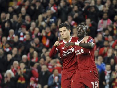 Liverpool's Sadio Mane (right), celebrates with Philippe Coutinho after their sixth goal against Spartak Moscow. AP