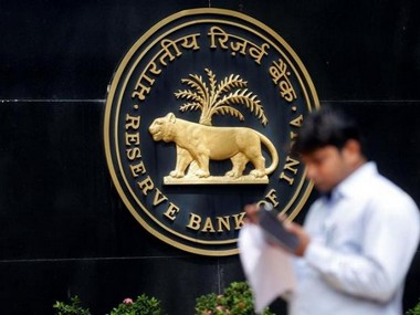 A man checks his phone outside the Reserve Bank of India (RBI) headquarters in Mumbai