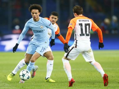 Manchester City's Leroy Sane, left, is challenged by Shakhtar's Bernard during their Champions League match. AP