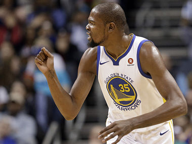 Golden State Warriors' Kevin Durant reacts to making a dunk against the Charlotte Hornets during the first half of an NBA basketball game in Charlotte. AP