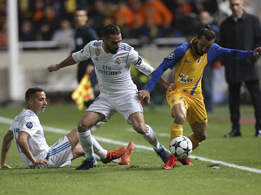 Real Madrid's Daniel Carvaja and his teammate Lucas Vazquez try to stop APOEL's Efstathios Aloneftis during the Champions League Group H match. AP