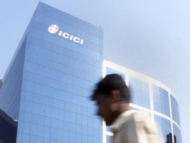 A MAN WALKS PAST THE ICICI HEADQUARTERS IN BOMBAY.