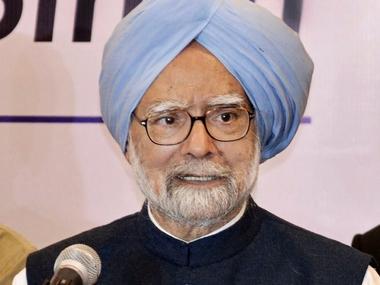 Former prime minister Manmohan Singh addresses a press conference in Rajkot on Thursday. PTI