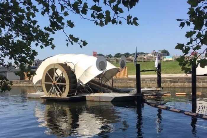 """The Waterwheel Powered Trash Interceptor, also known as """"Mr. Trash Wheel,"""" temporarily sported large googly eyes in 2015. Three such devices are now operating in Baltimore, Maryland. Image courtesy of Clearwater Mills LLC."""