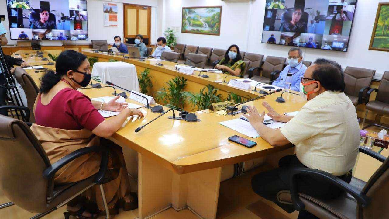 Union Minster Harsh Vardhan in conversation with the research team looking at the PCR testing kits and vaccine. Image credit: Twitter
