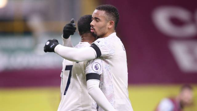 Manchester City's Raheem Sterling, left, celebrates with Manchester City's Gabriel Jesus after scoring his side's second goal during the English Premier League soccer match between Burnley and Manchester City at Turf Moor stadium in Burnley, England, Wednesday, Feb. 3, 2021. (Alex Pantling/Pool via AP)