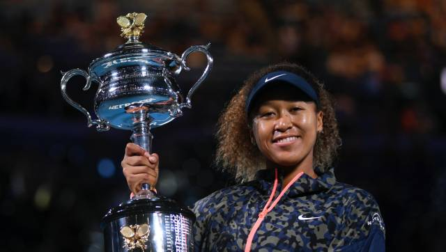 Japan's Naomi Osaka holds the Daphne Akhurst Memorial Cup aloft after defeating United States Jennifer Brady in the women's singles final at the Australian Open tennis championship in Melbourne, Australia, Saturday, Feb. 20, 2021.(AP Photo/Andy Brownbill)