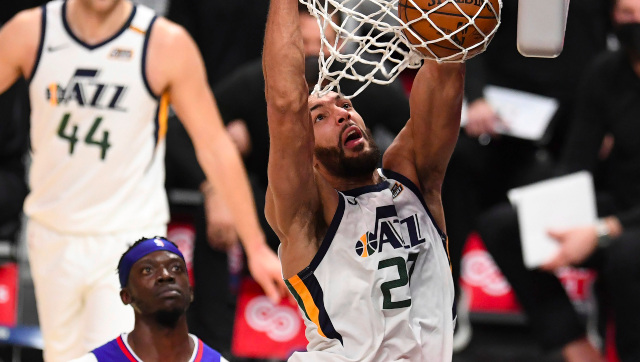 Rudy Gobert of the Utah Jazz slam dunks against the LA Clippers in the second half of a NBA game at the Staples Center in Los Angeles. AP